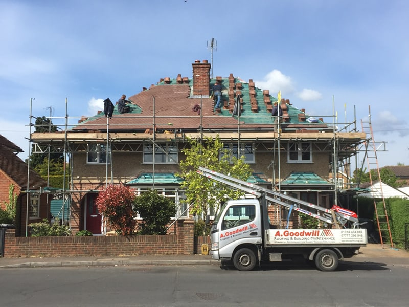 Roofers tiling a roof